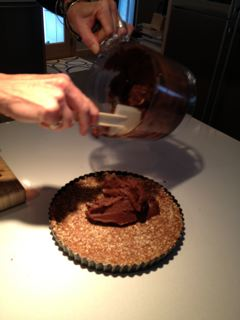 Turning the chocolate mixture onto the crust