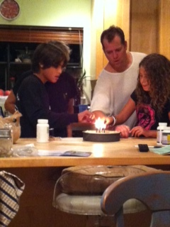 Ashley's family lighting the candles on hers!