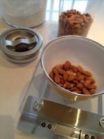 Weighing the almonds before milling