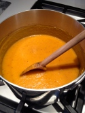 Stirring the pureed vegetables into the broth
