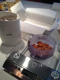 Weighing the almonds to grind