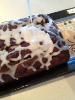 Drizzling with almond glaze; next time: vegan chocolate ganache!