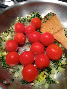 Whole cherry tomatoes into the pan