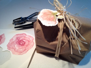 Watercolor rose tag tied with raffia