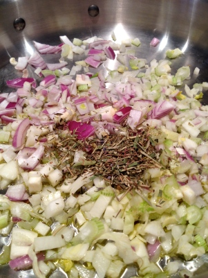 Chopped onion, fennel, and Herbs de Provence in a saute pan
