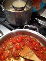Adding chicken broth to the sauce