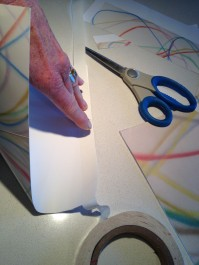 Applying double stick tape to a short side