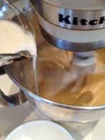 Alternately adding the almond milk and flour mix