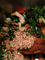 Tossing the sesame seeds into the chard