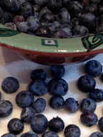 Washed blueberries in a ceramic berry bowl