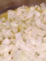 Chopped onion into the pot