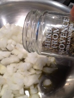Adding Herbs de Provence to the onions