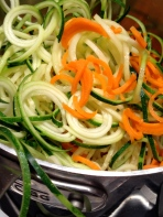 Zucchini and carrots into the hot water