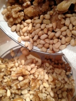 Adding the pine nuts to the beans and walnuts