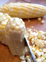 Break the cobs in half to more easily cut off the kernels