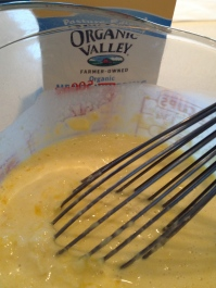 Whisking the corn, yolk, and cream