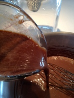 Pouring the yolks and chocolate back into the chocolate cream