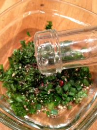 Adding the vinegar to the herbs