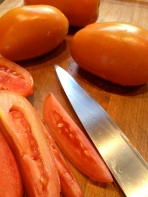 Slicing tomatoes, warm from the garden