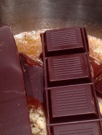 Adding the chocolate to the hot coconut oil