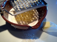 Grating cold butter into the dry ingredients