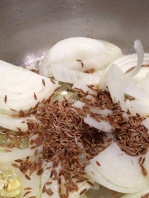 Cumin seeds in the with the onion