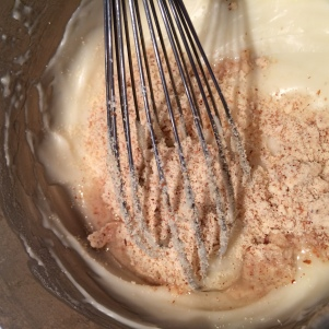 Whisking in the coconut oil and almond flour