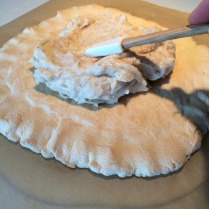 Spreading the cooled pastry cream on the the baked crust