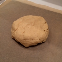 Dough ready to roll on the prepared pan