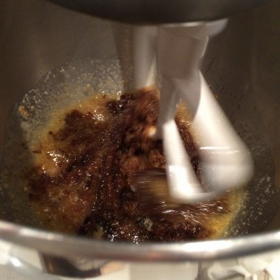 Beating the sugar, molasses and melted butter