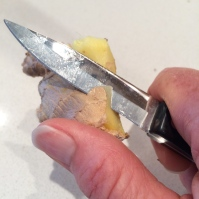 Peeling ginger root
