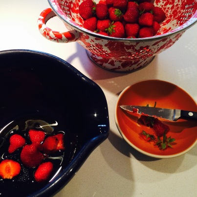 Hulling and halving the strawberries